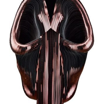 "Iris van Herpen, ""Hybrid Holism,"" Dress, July 2012, Metallic coated stripes, tulle, and cotton, Collection of the designer, Photo by Bart Oomes, No 6 Studios"